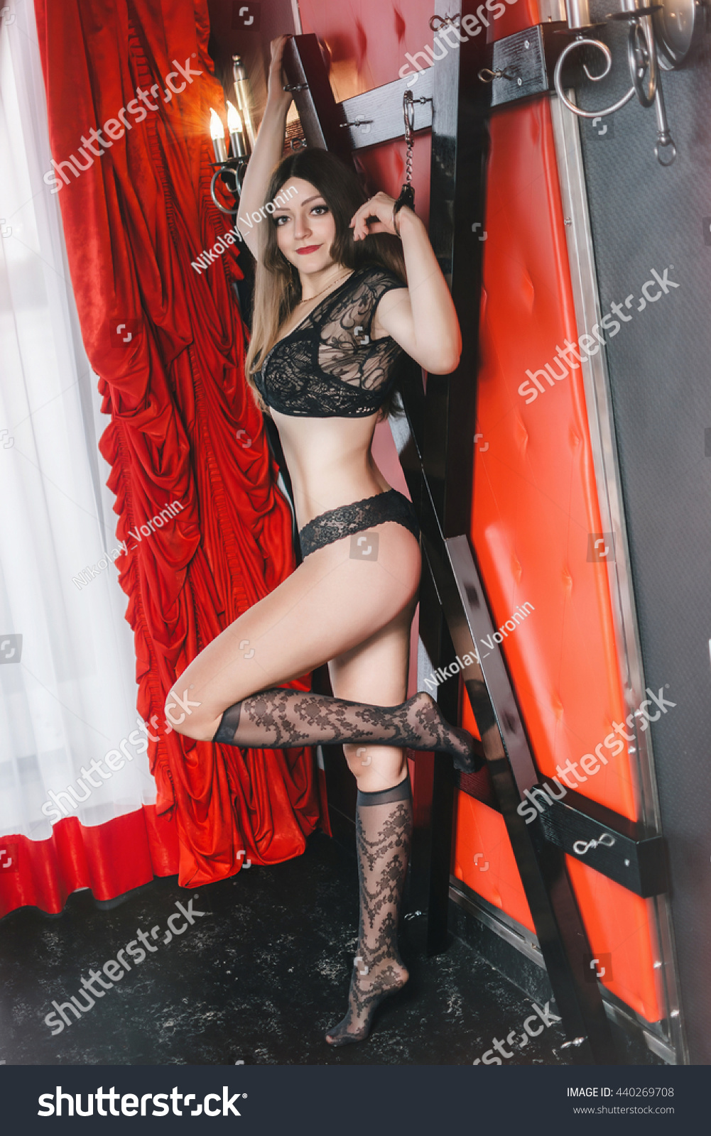 sexual women, young girl in handcuffs in bdsm room, role-playing games,