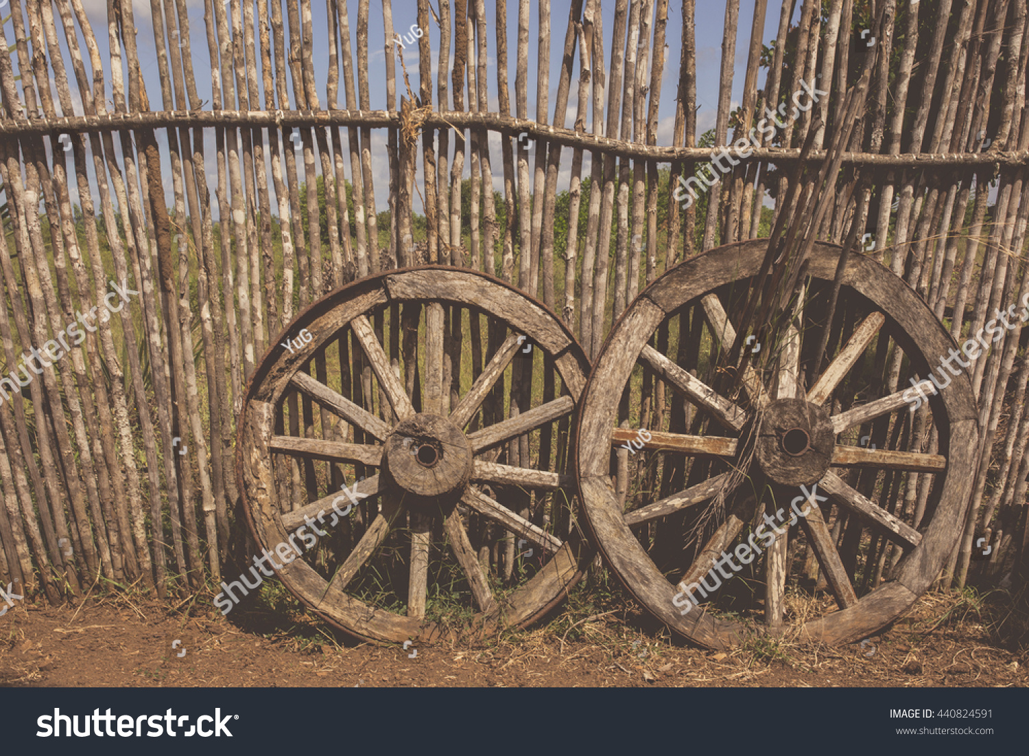 Two Old Waggon Wheels Near The Wooden Fence Old Cart Wheel As A