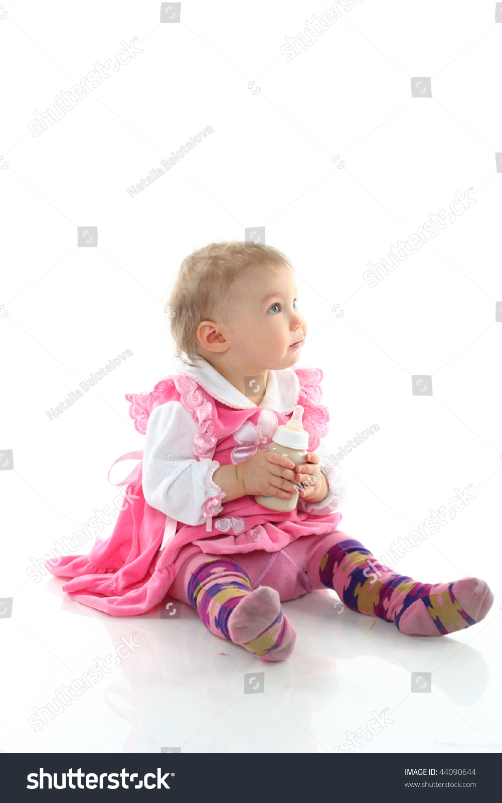 pretty baby girl drinking milk bottle stock photo (download now