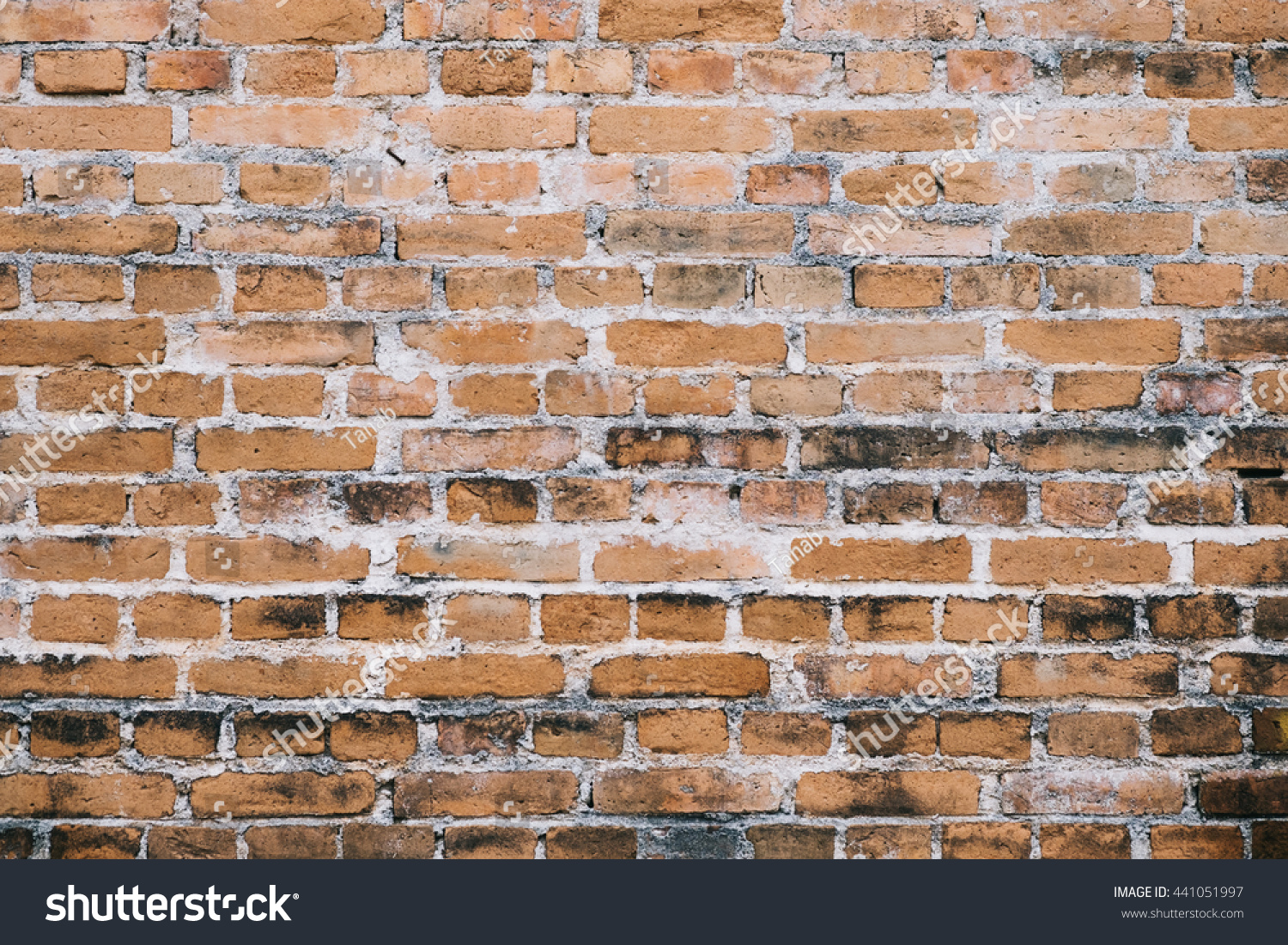 Dark brick wall background used background stock photo for Material design space