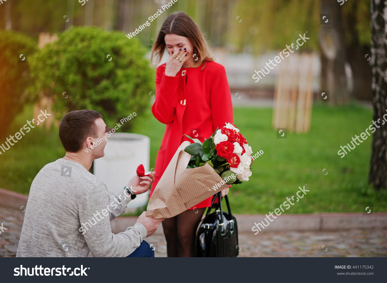 Marriage Proposal Man Boquet Flowers Kneeling Stock Photo