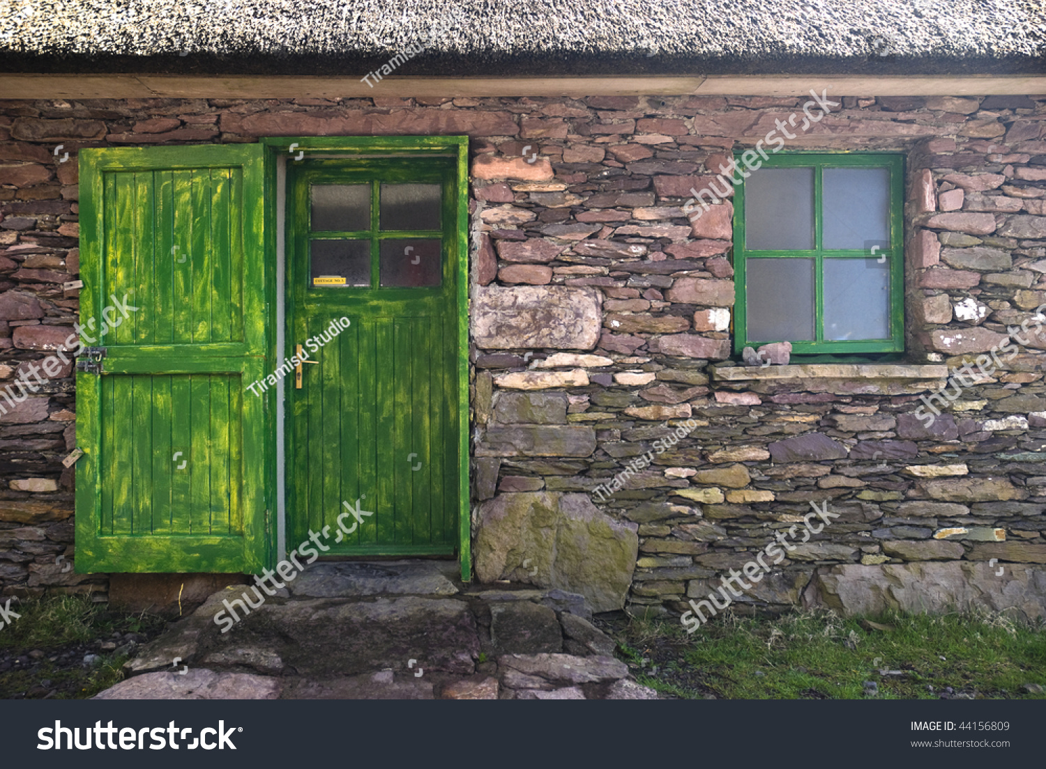 Old Historic Stone Cottage Door Window Stock Photo