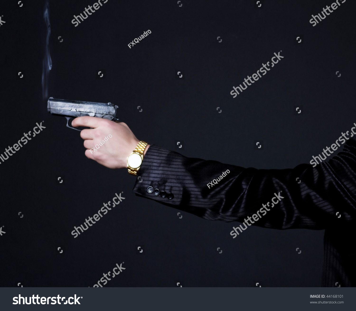 Picture Of Hand In Suit Holding A Smoking Gun Stock Photo