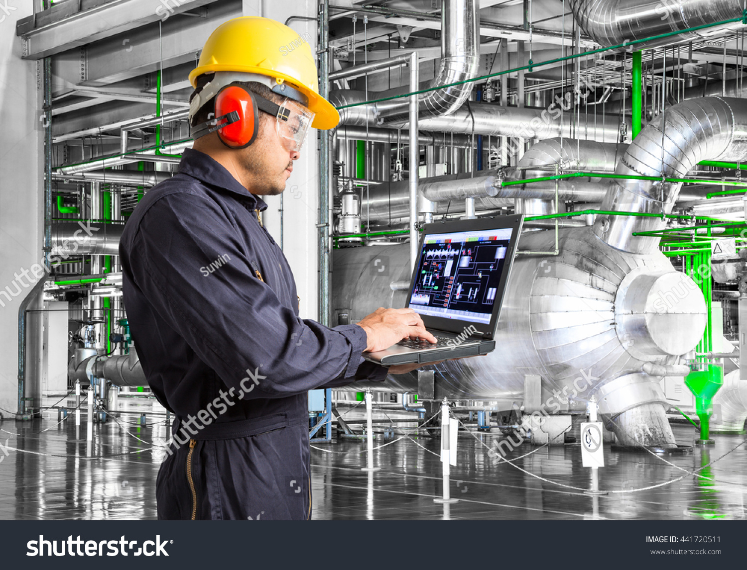 engineer using laptop computer in thermal power plant factory - Power Plant Engineer
