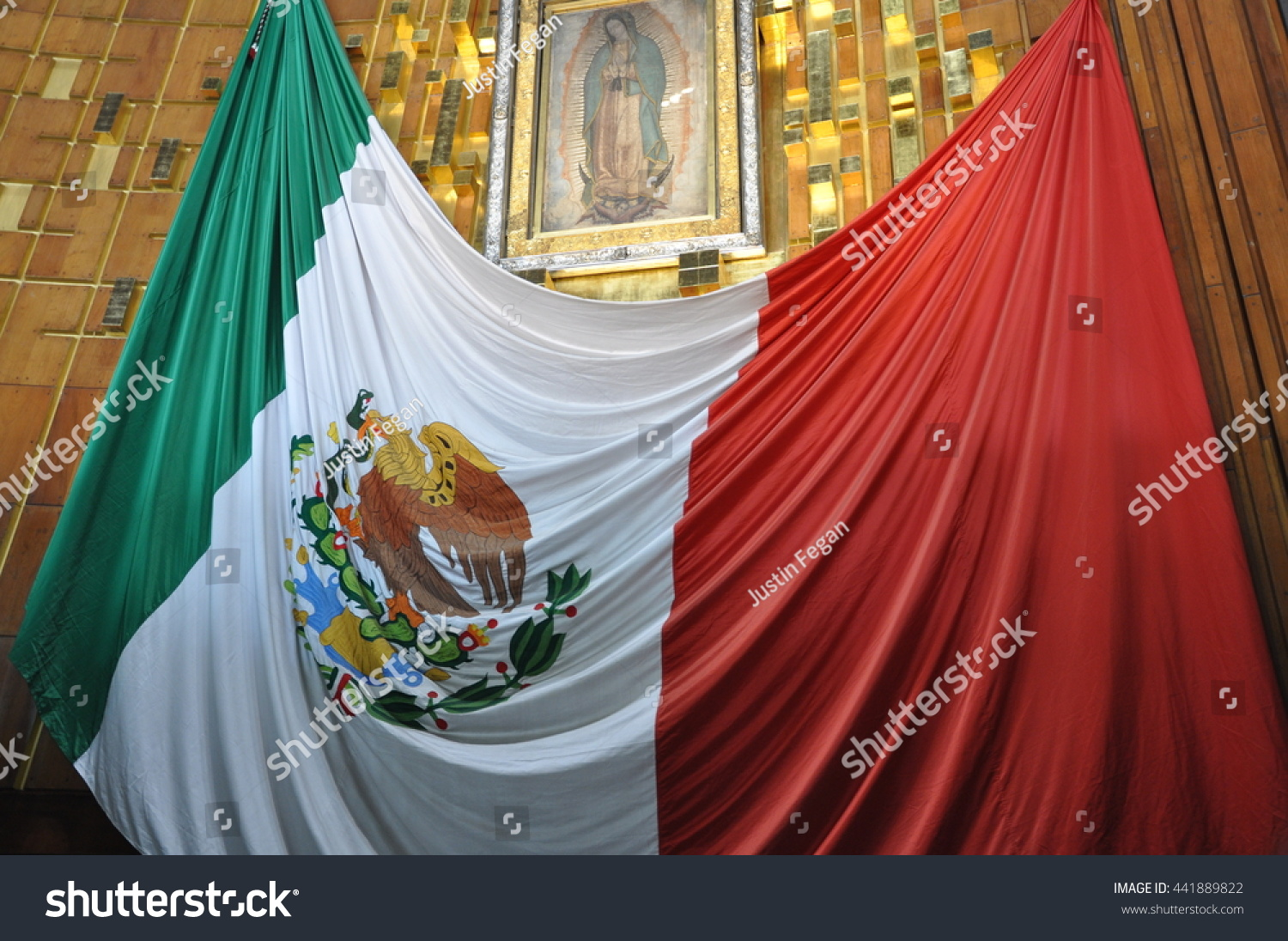 January 2016 Basilica of Our Lady of Guadalupe Mexico City The Mexican Flag hanging underneath the shrine to Guadalupe inside the basilica