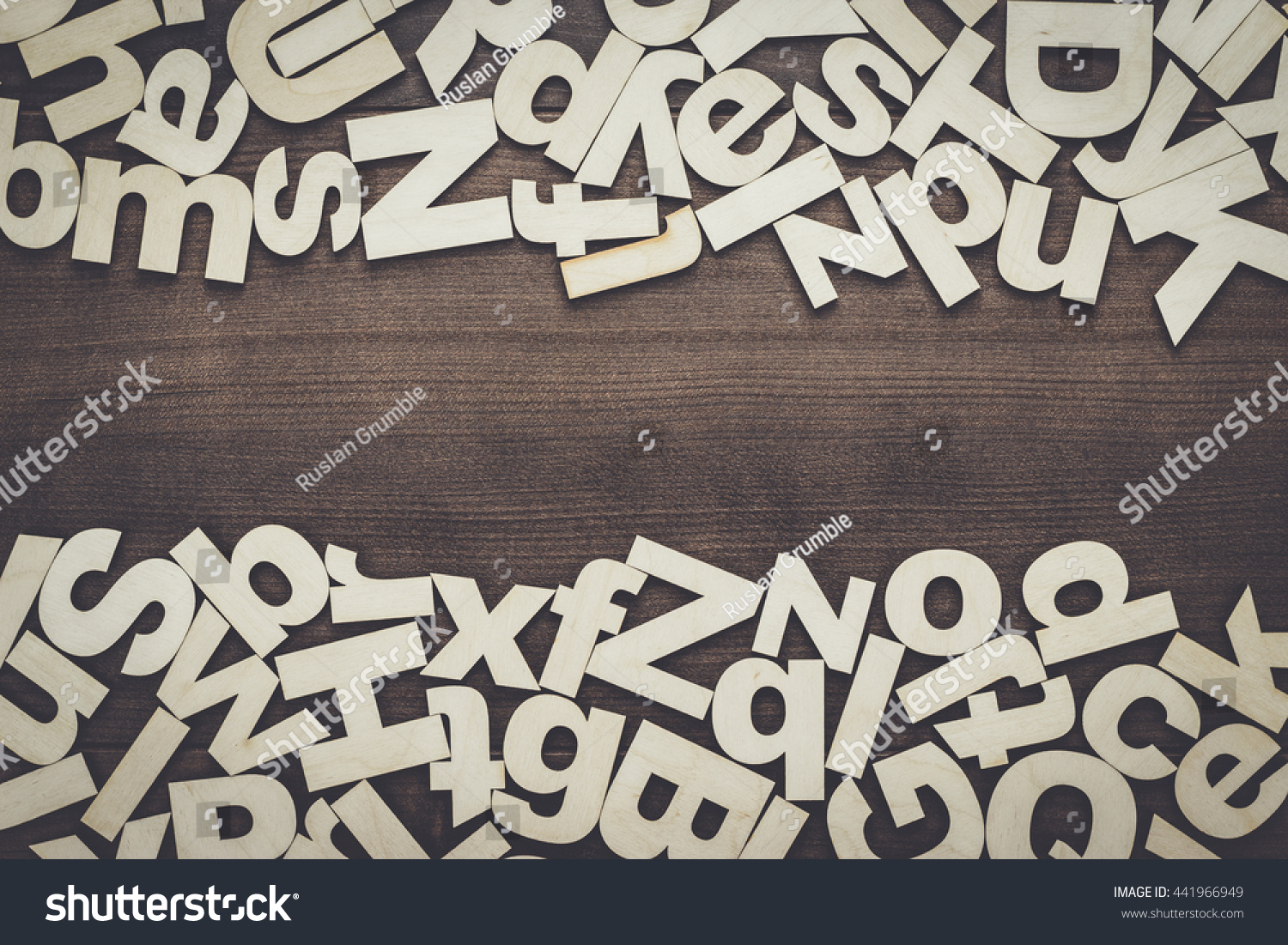 uppercase and lowercase wooden letters background on the table preview save to a lightbox