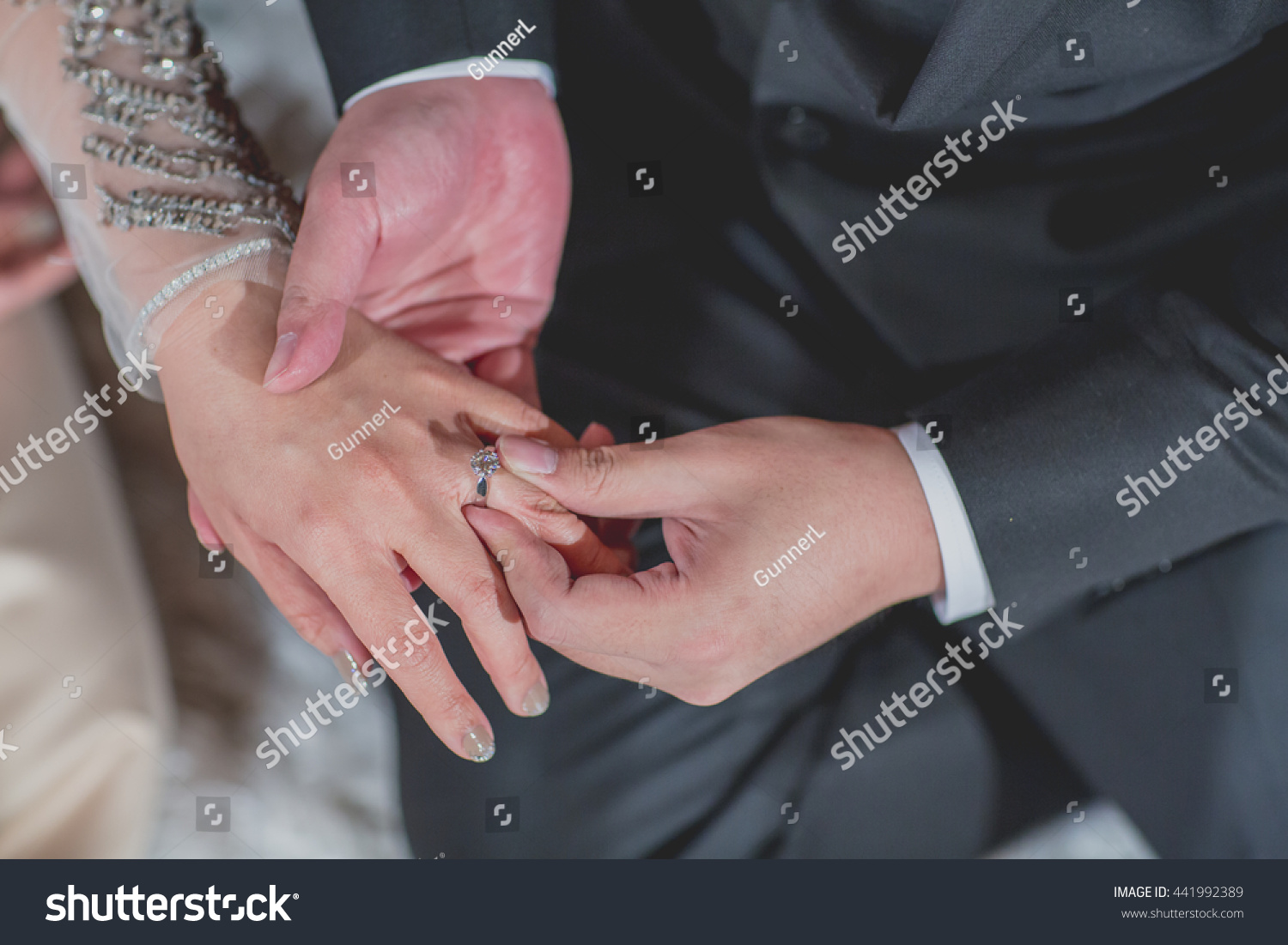Grooms Hand Putting Wedding Ring On Stock Photo (Royalty Free ...