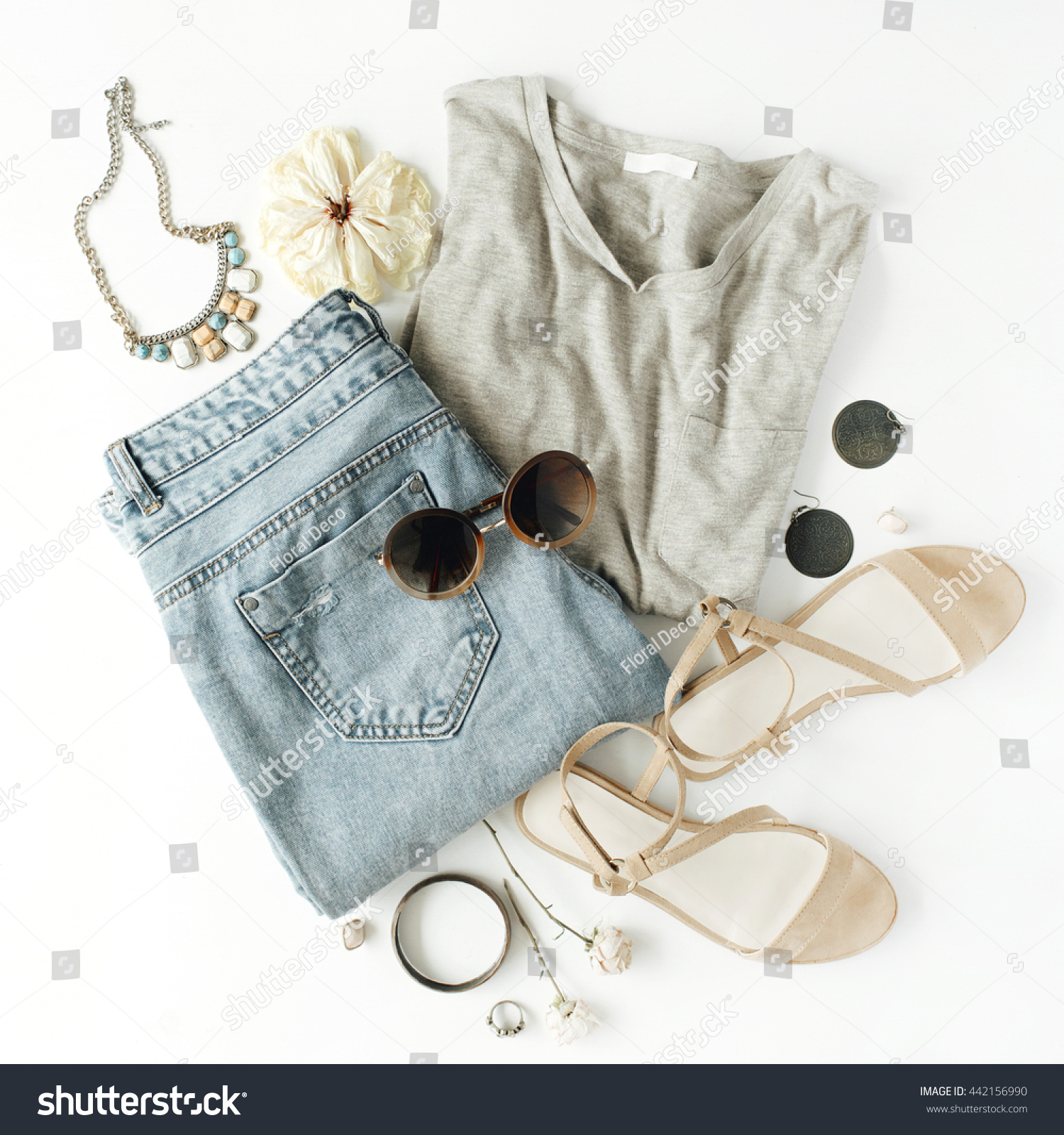 950a303dce6f flat lay feminine clothes and accessories collage with shirt, jeans shorts,  sunglasses, bracelet, sandals, earrings on white background.