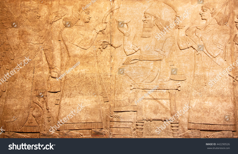 Ancient sumerian stone carving cuneiform scripting stock
