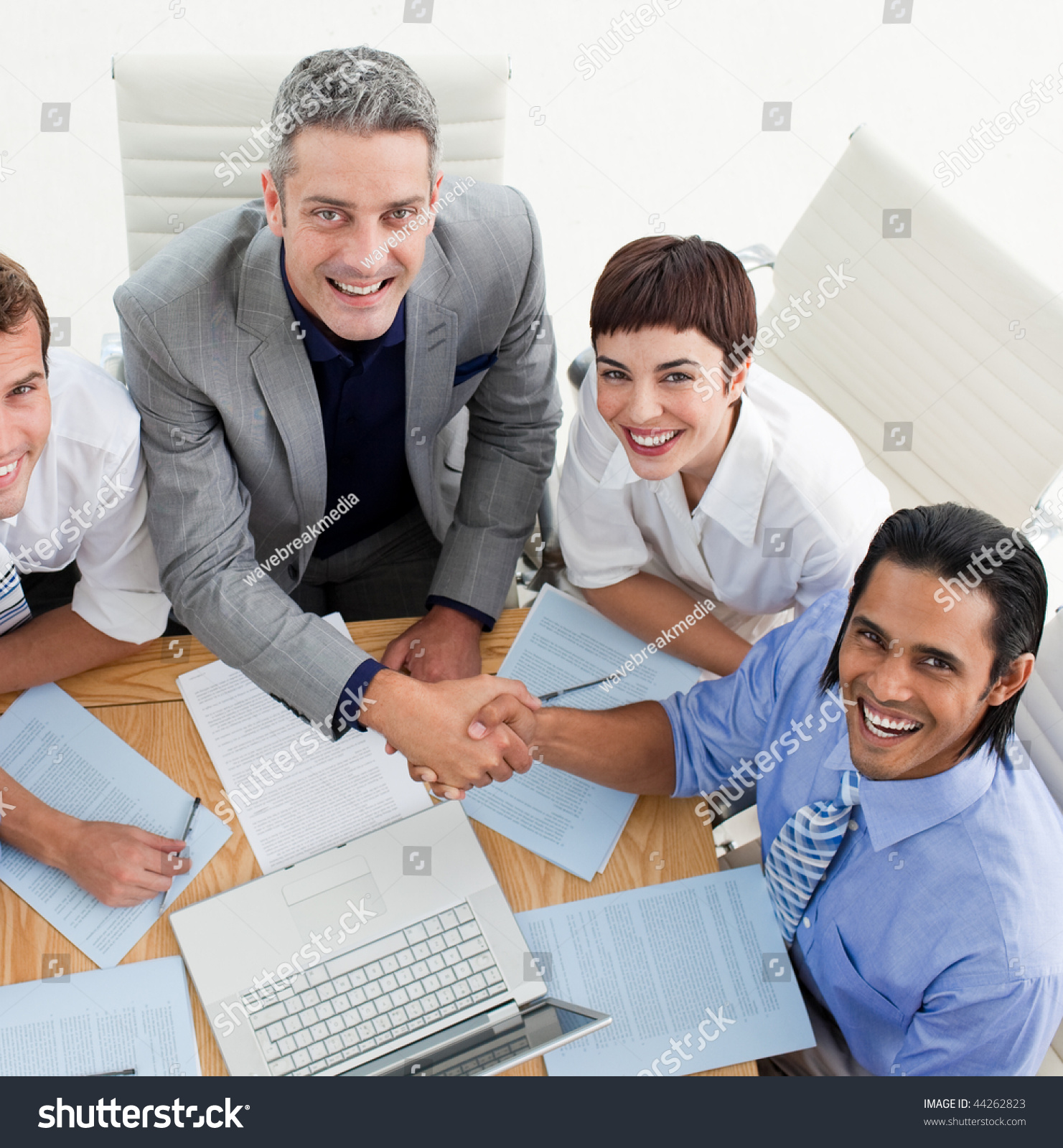 Two Smiling Business People Greeting Each Stock Photo Edit Now