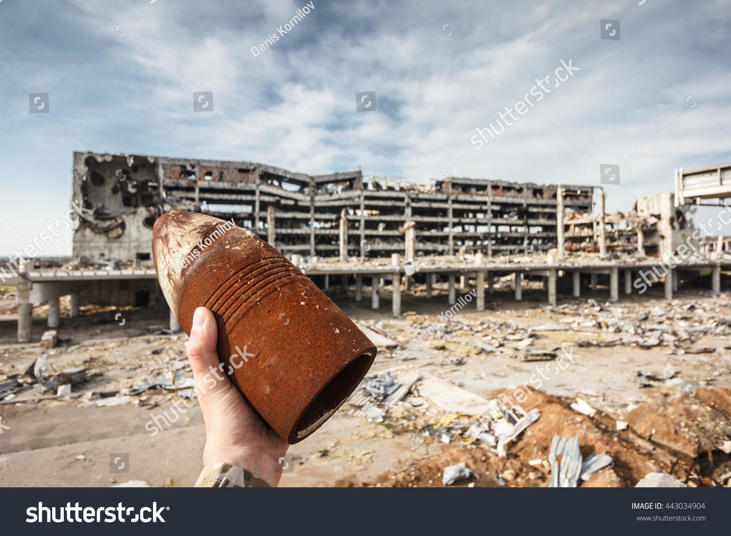 Mortar Shell Logo : Unexploded mm artillery shell hand stock photo