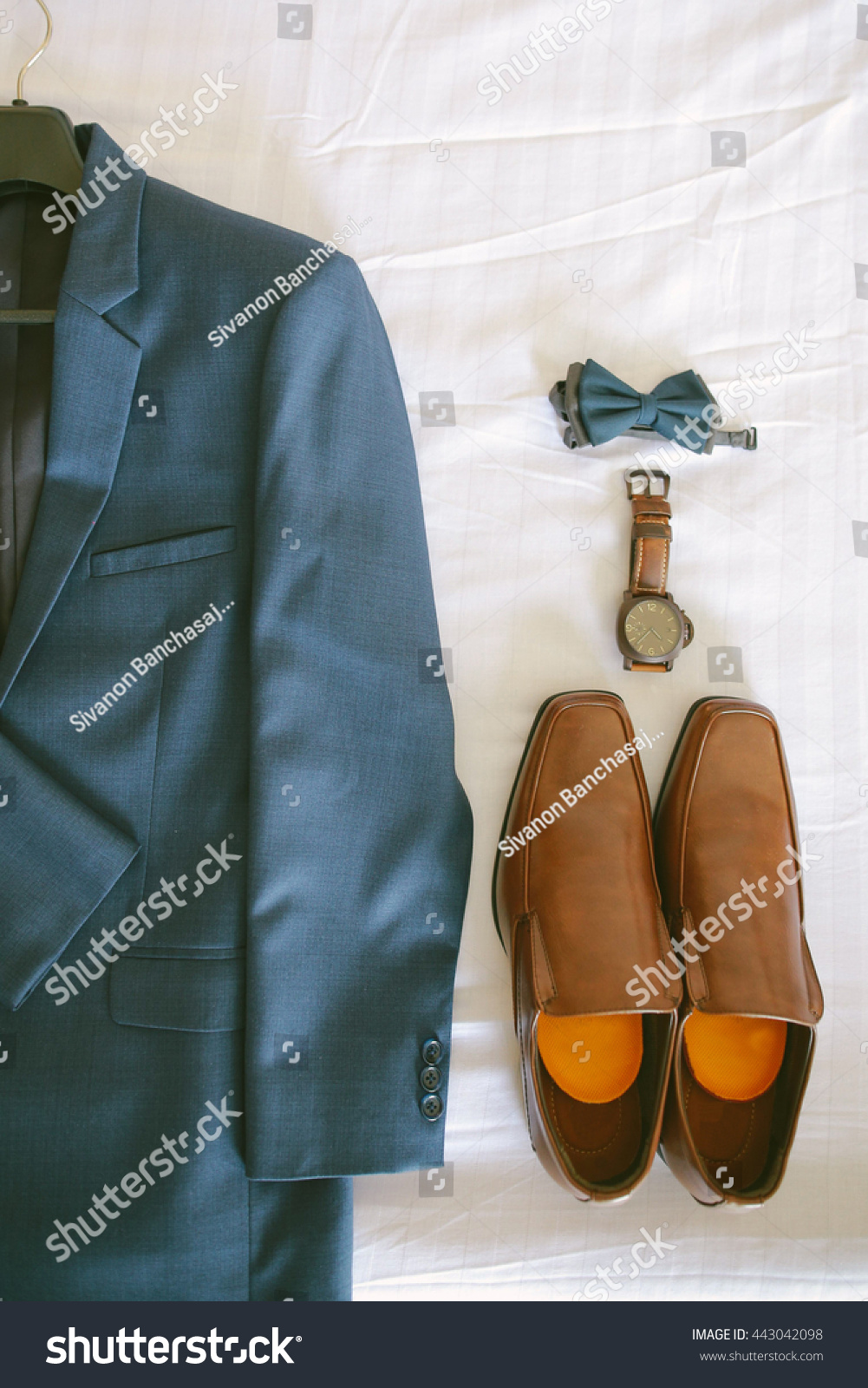 Royalty-free Blue suit, brown shoes, watch and bow… #443042098 Stock ...