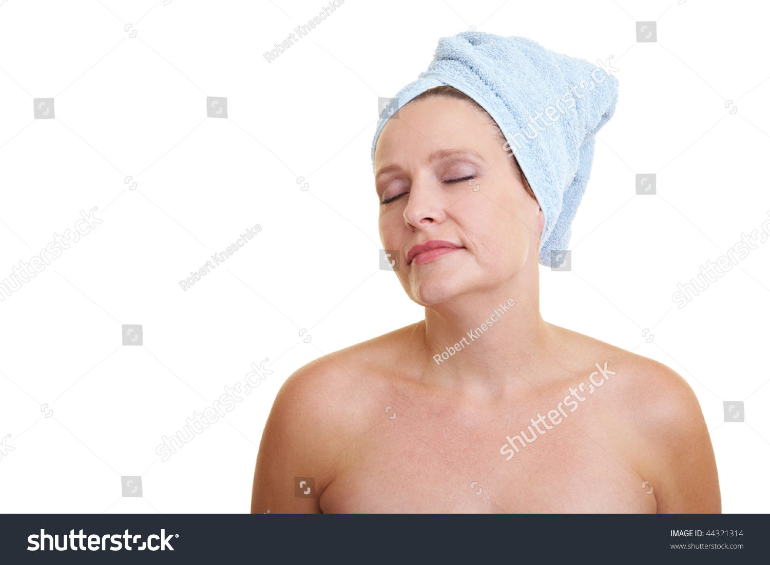 beautiful young woman with a towel on her head after