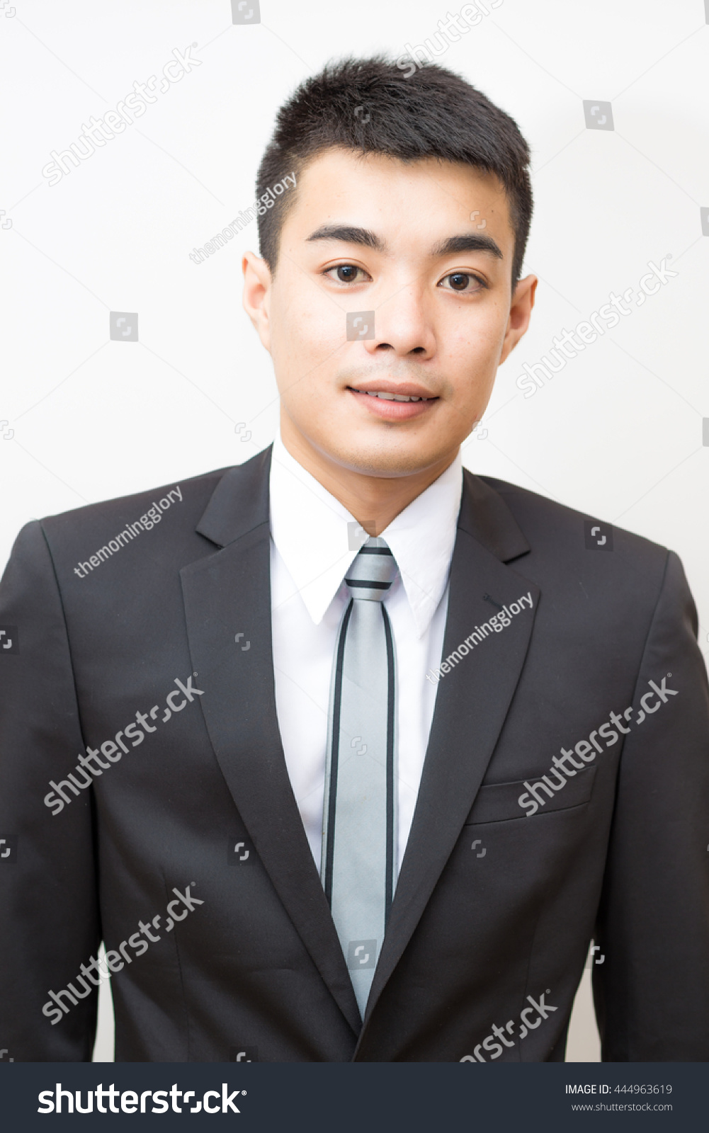 Young good smart looking asian professional business man on a white  background isolated