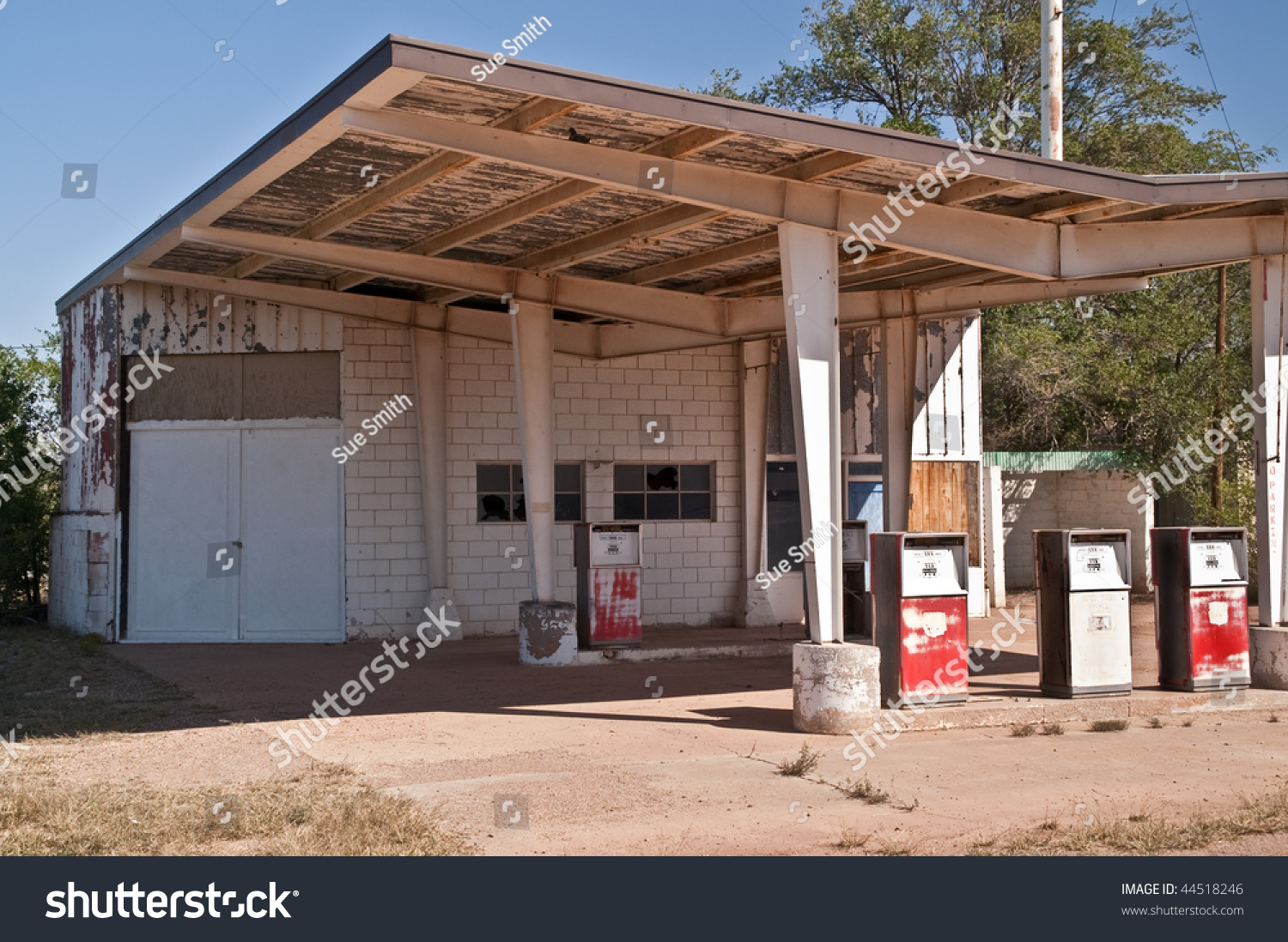 abandoned gas station auto repair shop stock photo (edit now