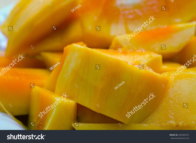 Mango, Beautiful Nicely Cut Yellow Mango On The Plate Stock Photo