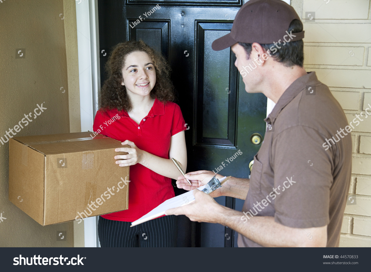 Delivery man brings a package to a customeru0027s door and waits for a signature.  sc 1 st  Shutterstock & Delivery Man Brings Package Customers Door Stock Photo 44570833 ... pezcame.com
