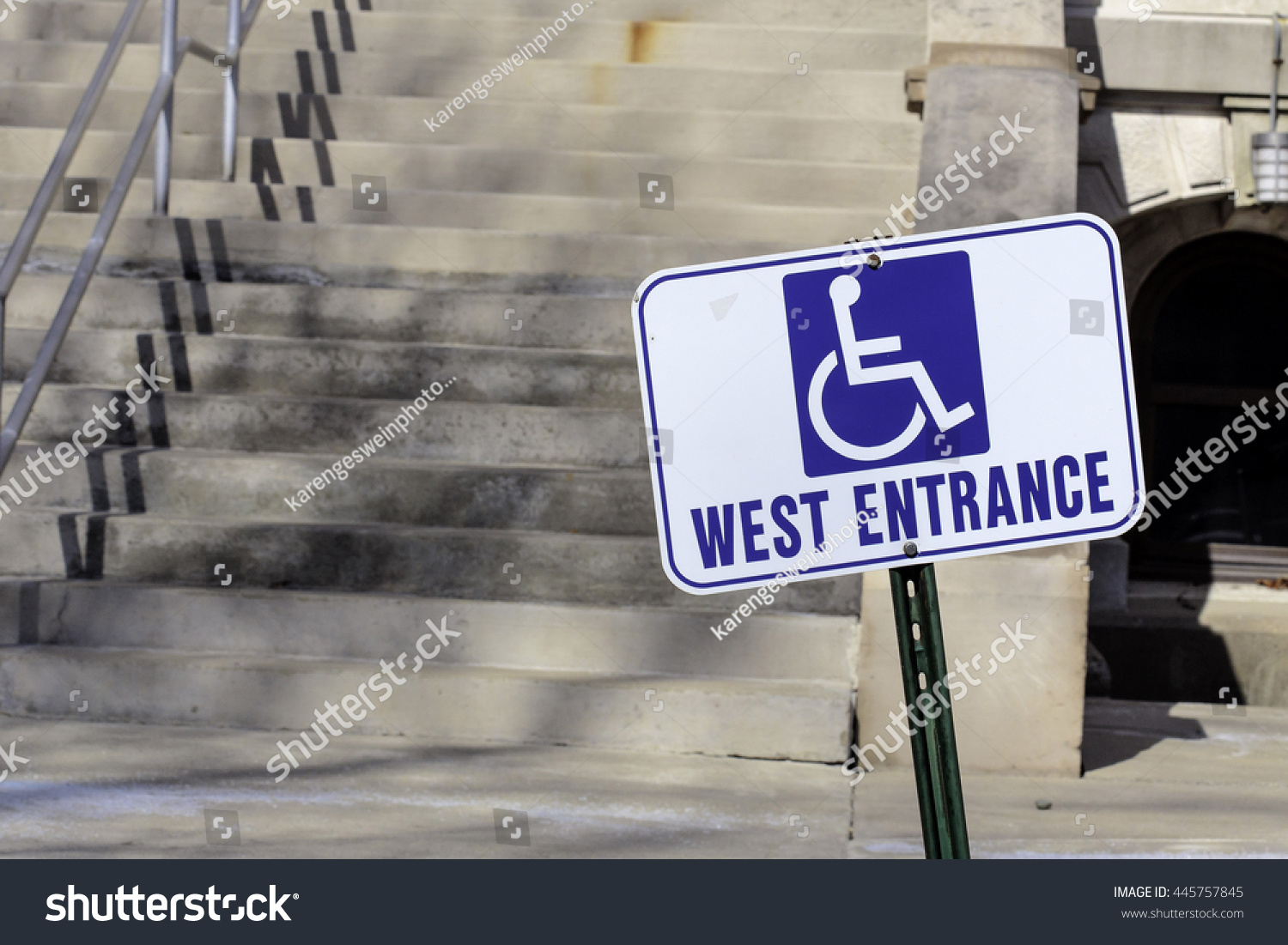 handicap entrance sign by steep cement stock photo royalty free
