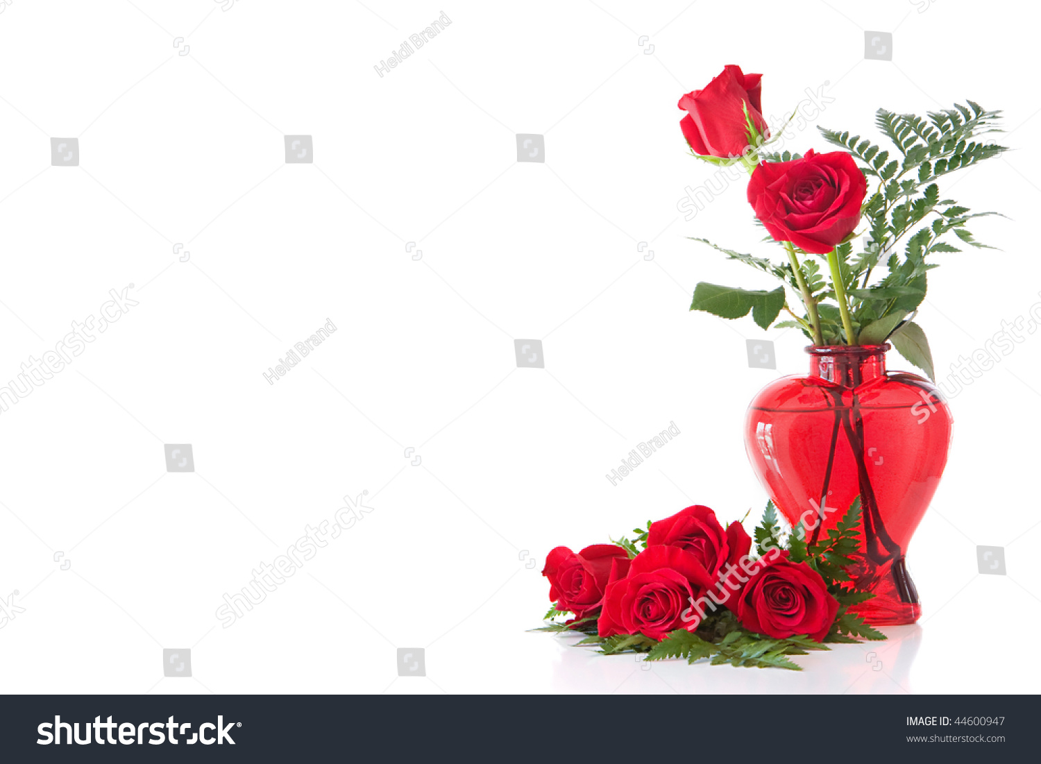 Red glass heart shaped vase containing stock photo 44600947 red glass heart shaped vase containing 2 long stem red roses with some more red reviewsmspy