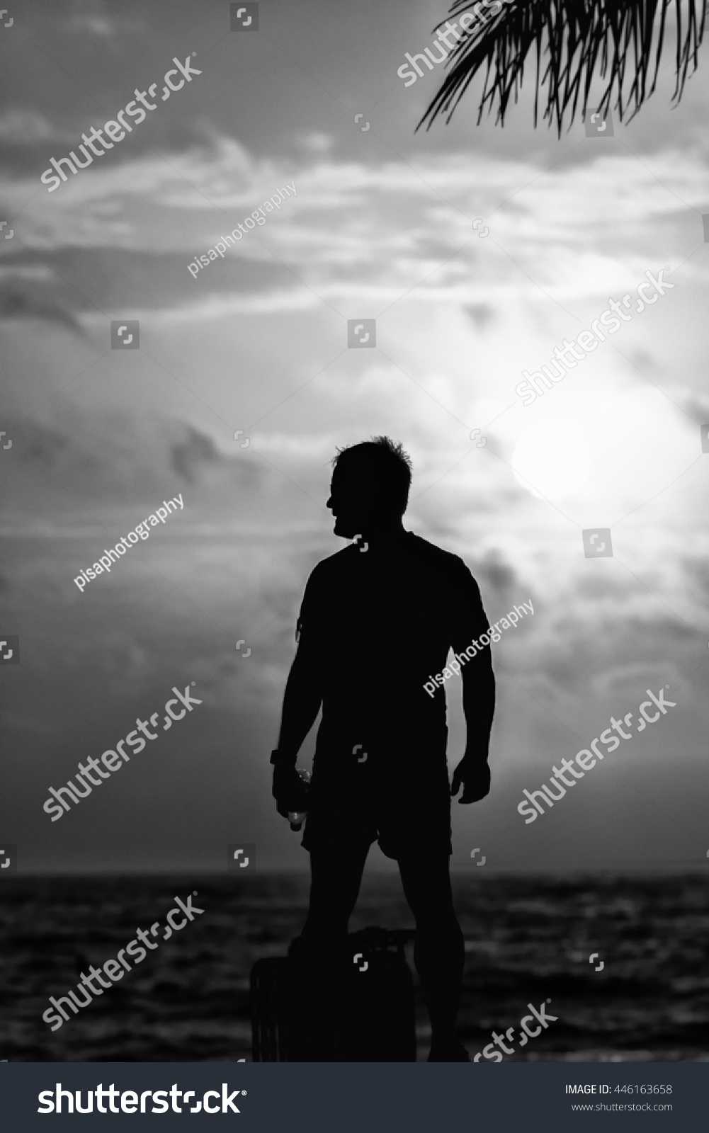 Black And White Man Silhouette On The Beach