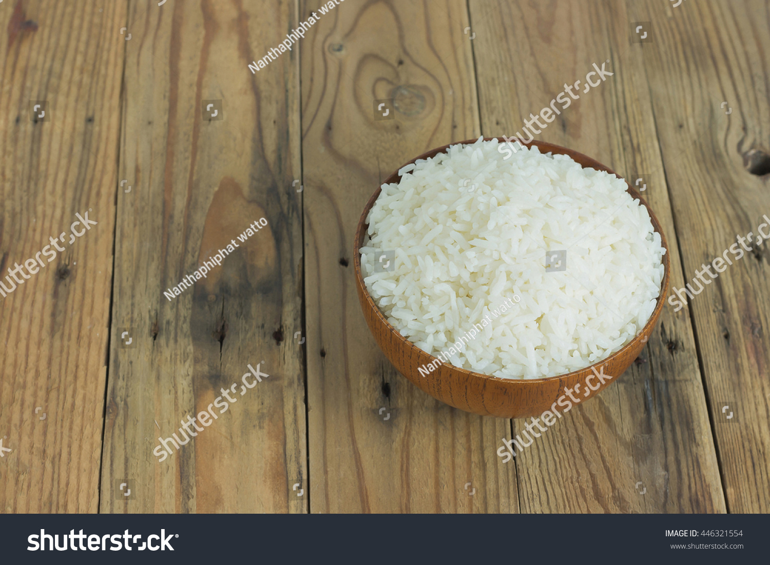Cooked rice in bowl on old wooden table. with copy space for write text. #446321554