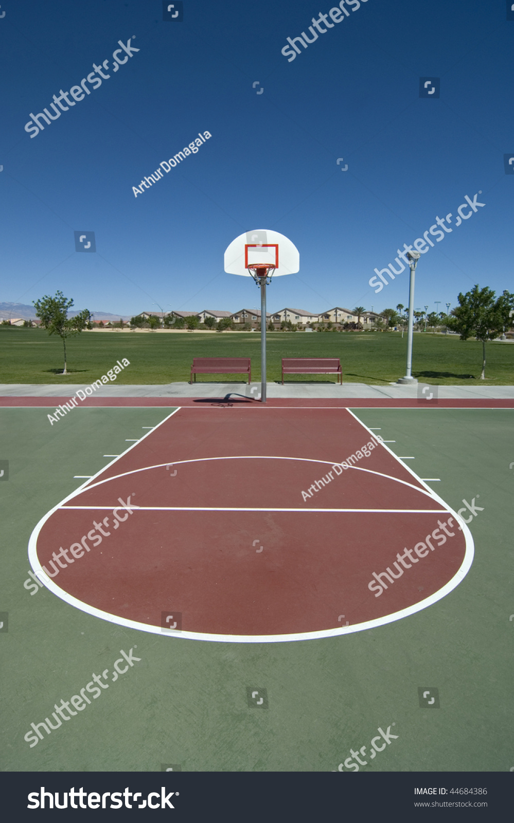 A wide angle shot of a red and green basketball court from for How wide is a basketball court