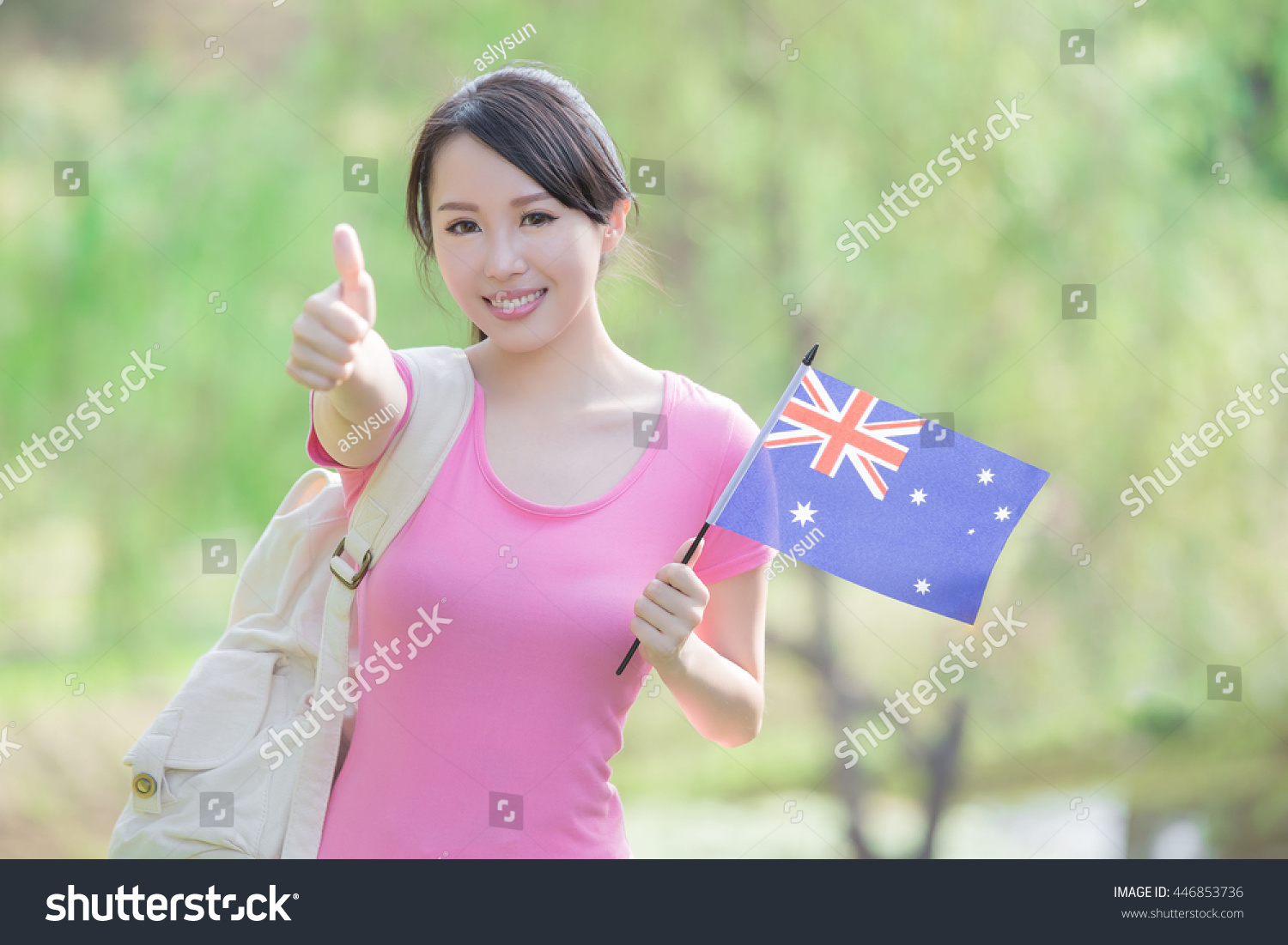 happy college student girl hold australian stock photo