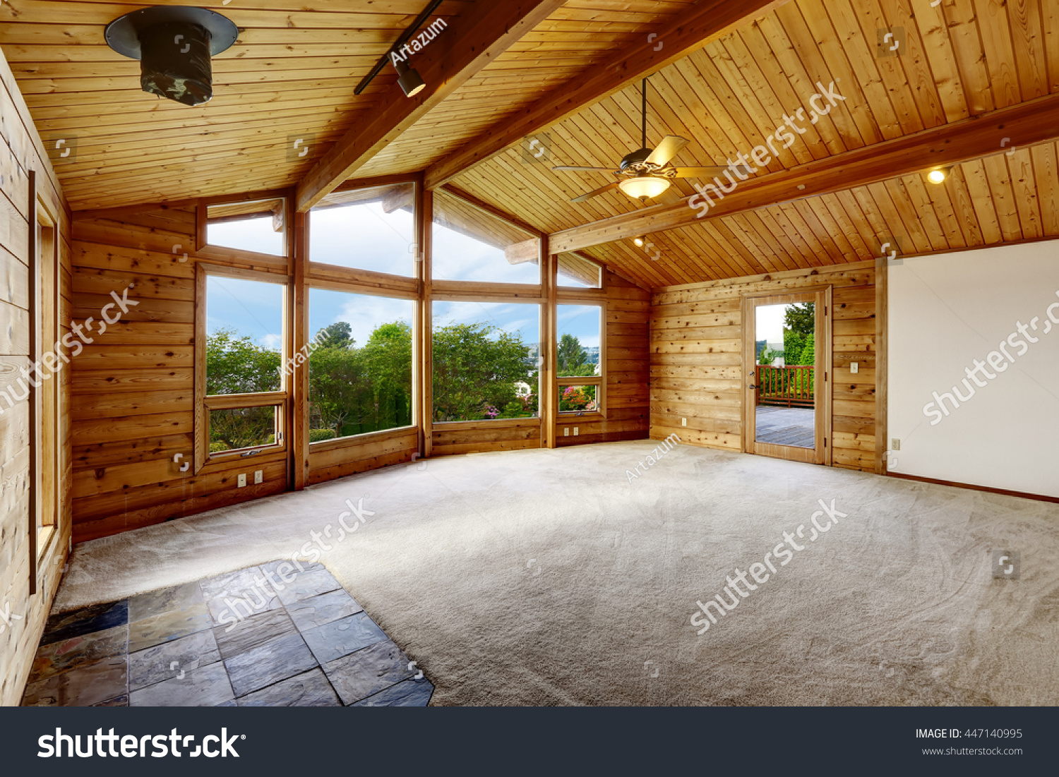 Empty living room with carpet - Empty Living Room With Carpet Floor In Wooden Trim House With Large Windows And Balcony Door