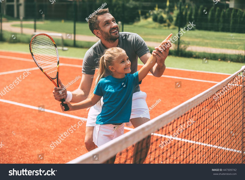 Tennis fun when father near cheerful stock photo 447309742 for Sports shirts near me