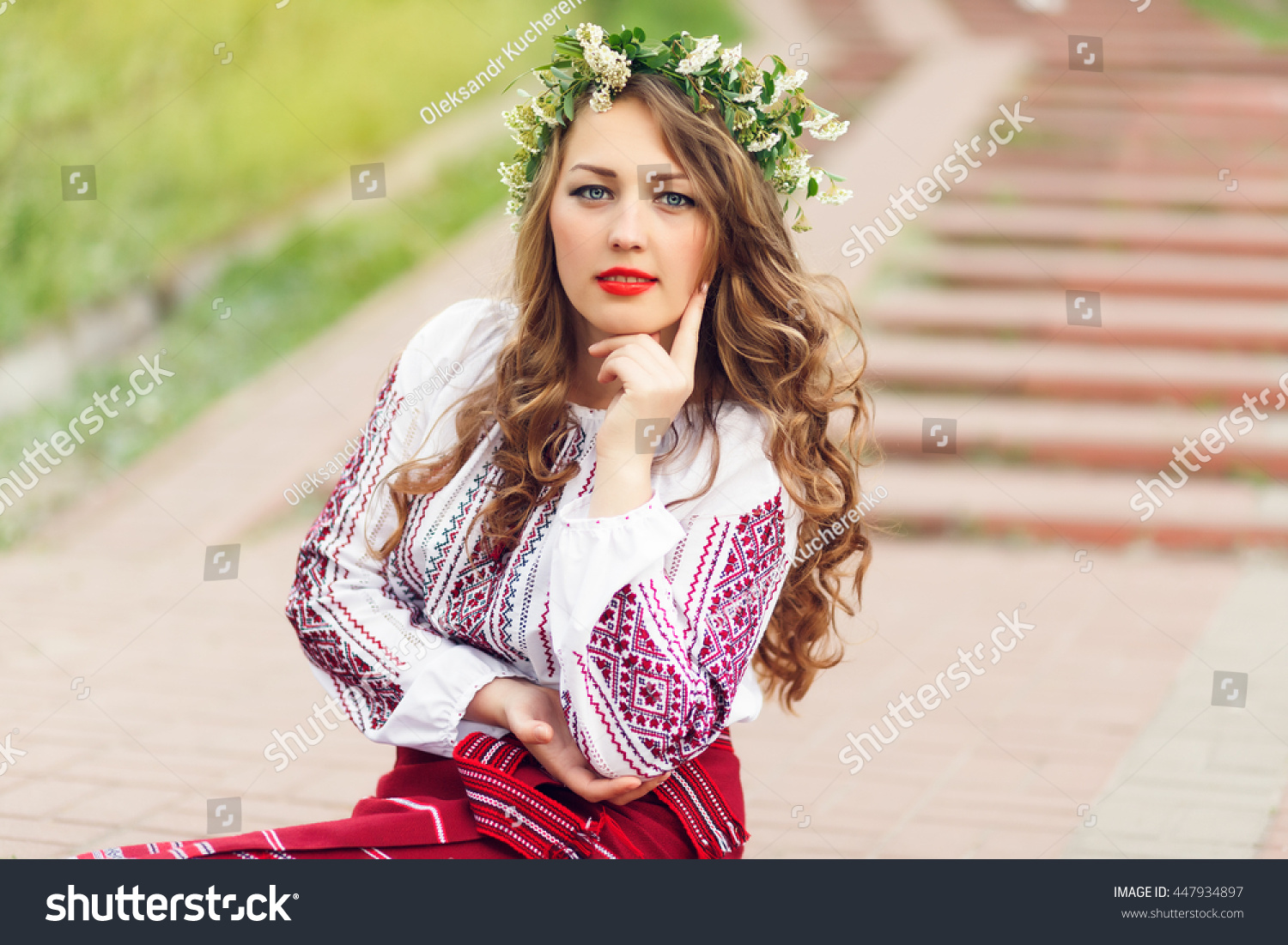Royalty free beautiful ukrainian blonde girl wears 447934897 beautiful ukrainian blonde girl wears ukrainian traditional costume vyshyvanka sits on the stairs in the park in flower crown stock photo dhlflorist Gallery