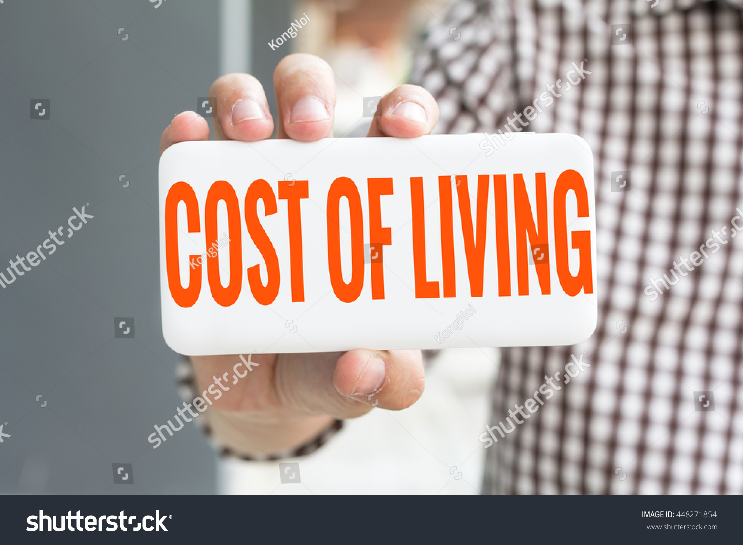 Man Hand Showing COST LIVING Word Stock Photo (Edit Now) 448271854