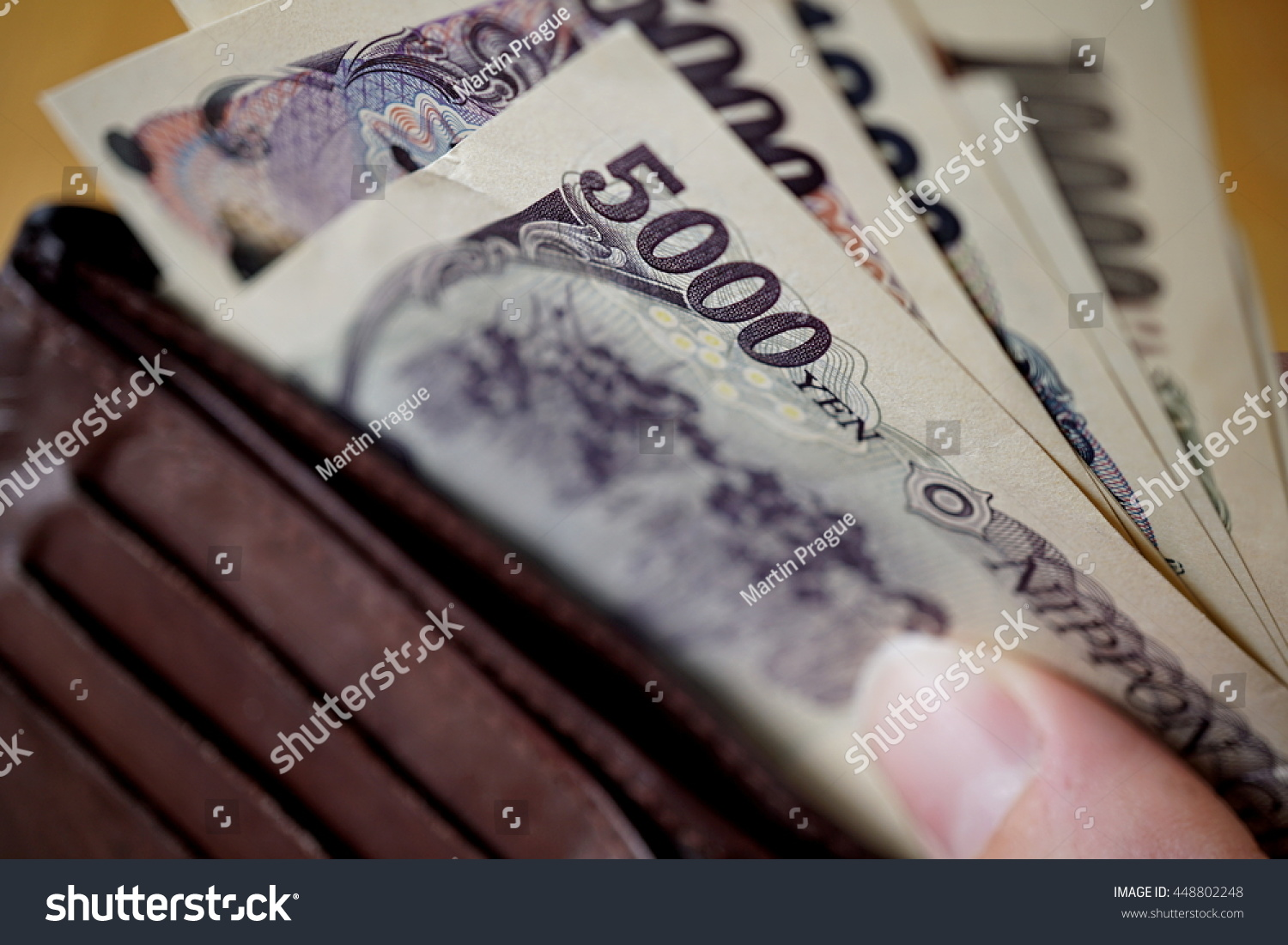 Male Hand Holding Japanese Currency Yen Stock Photo Edit Now