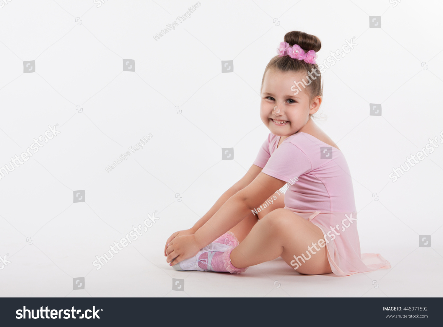 5d0435403 Little girl is sitting on the floor. The concept of a happy ...