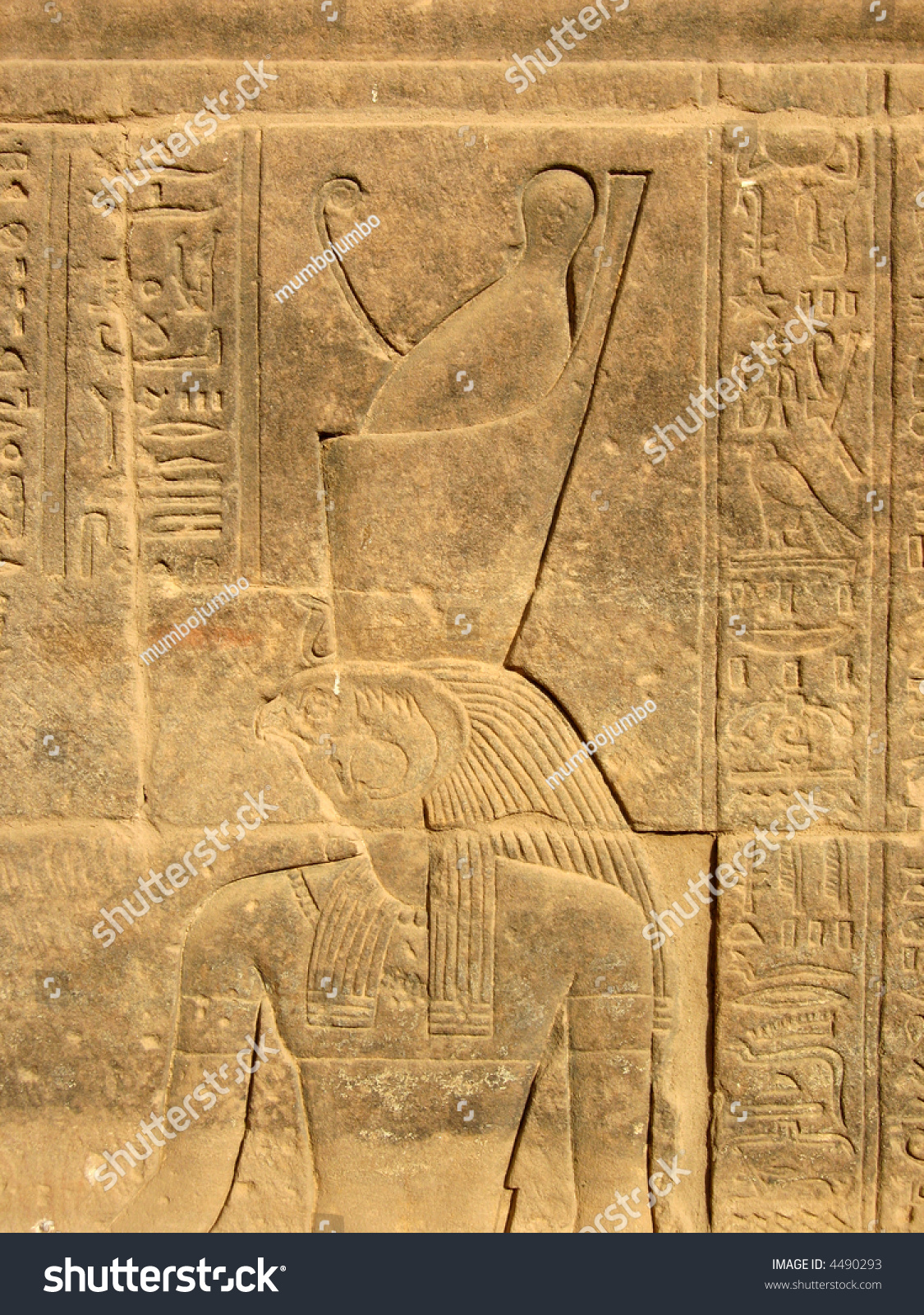 Ancient egyptian hieroglyphics carved into stone stock
