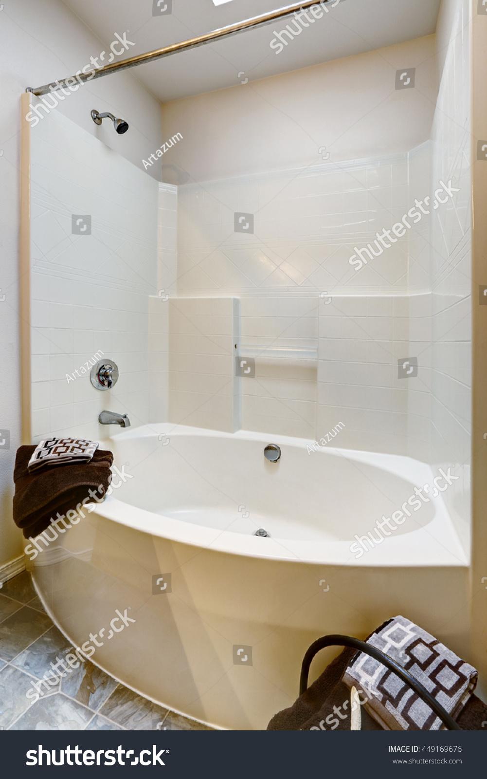 New bathroom with tile floor and white bathtub. | EZ Canvas