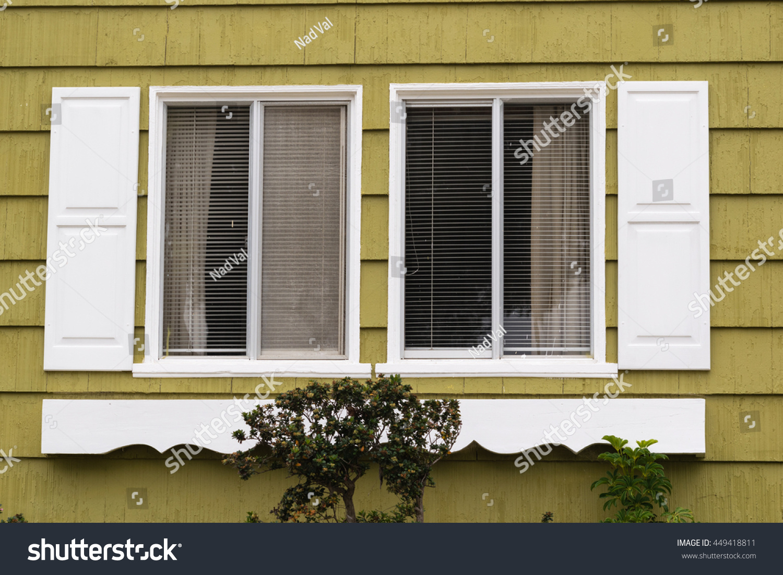Double Sliding Window Faux Shutters Decorated Buildings