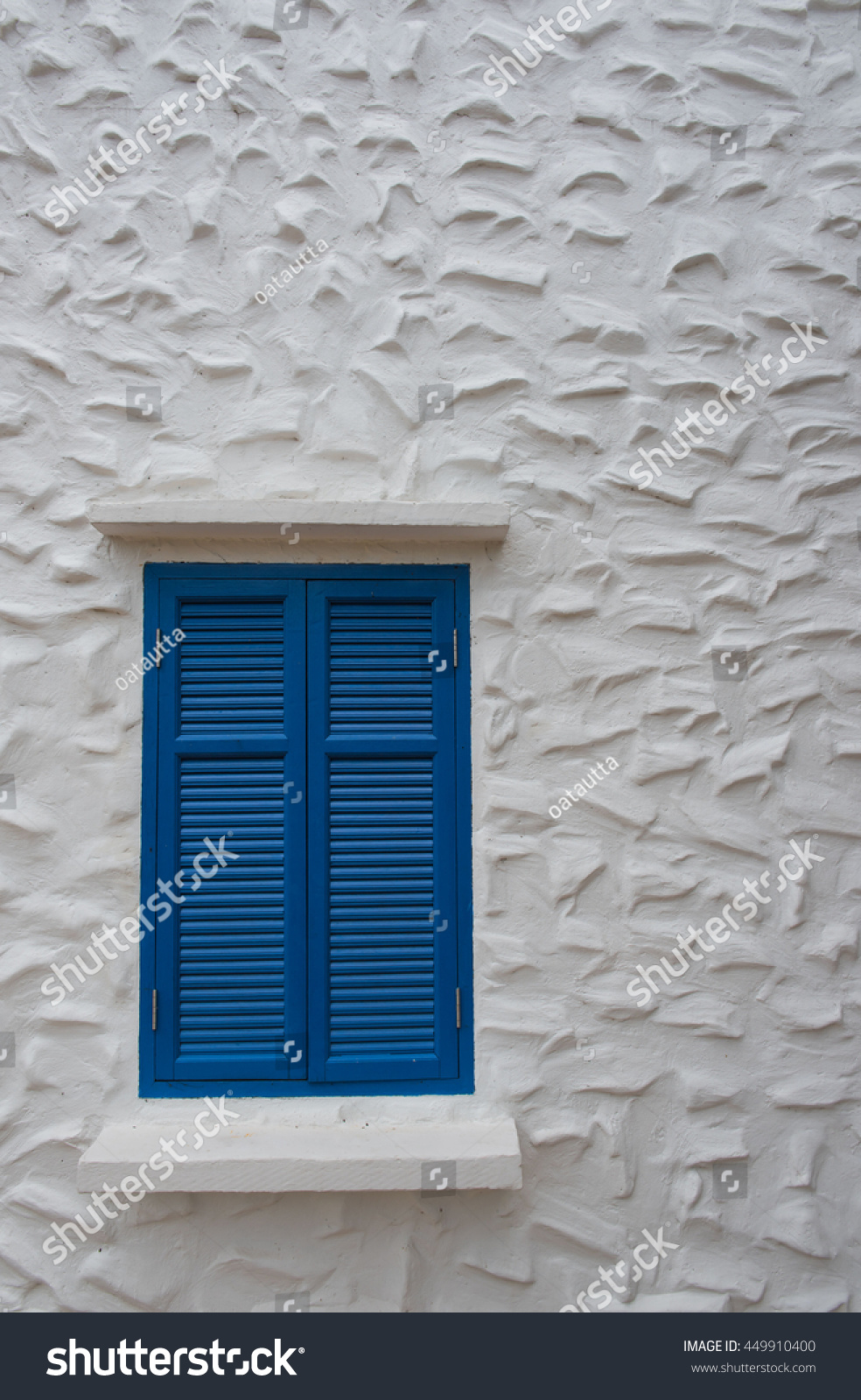 Stucco On Frame : Blue wooden window frame on building stock photo