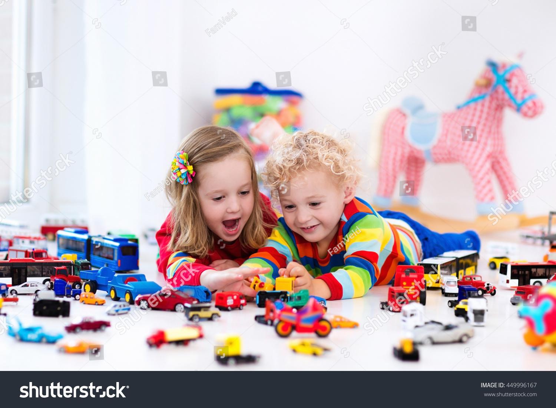 little toddler boy girl playing model stock photo 449996167 shutterstock. Black Bedroom Furniture Sets. Home Design Ideas
