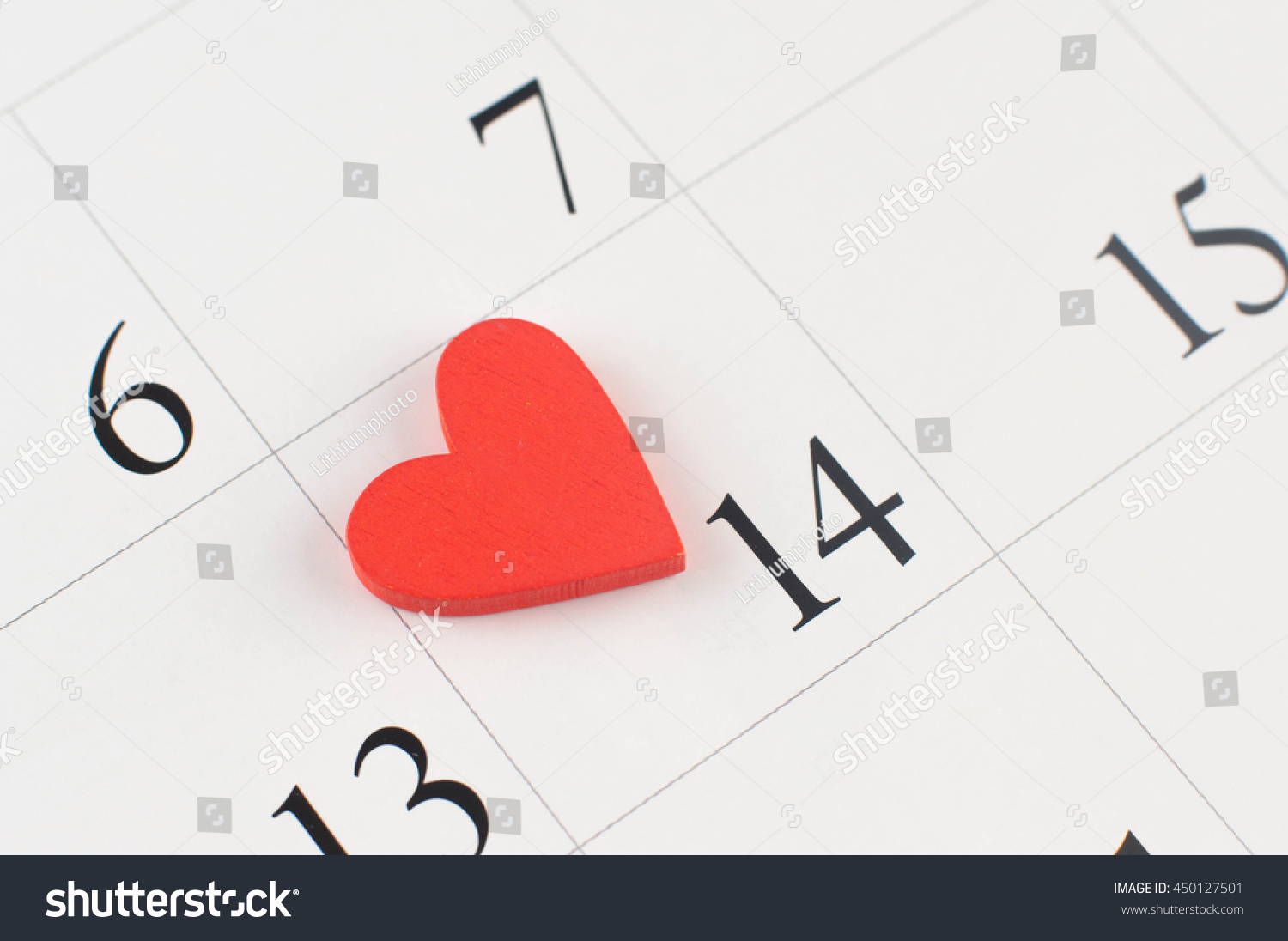 Closeup wooden heart on calendar page stock photo 450127501 closeup of wooden heart on the calendar page on data 14th small depth of field buycottarizona Gallery