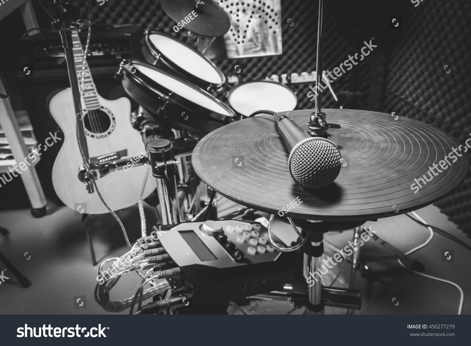selective focus the microphone and music instruments the guitar electric drum speakers background music production band concept