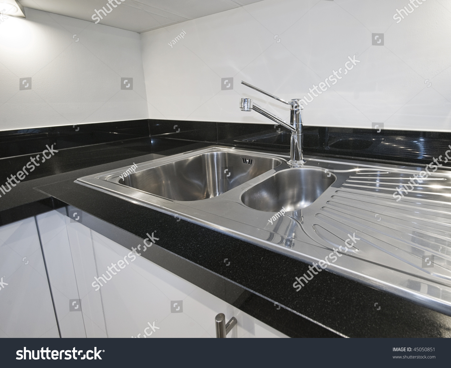 Stainless Steel Kitchen Sink Detail On Stock Photo