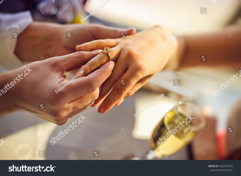 Man Wears Wedding Ring On Womans Stock Photo 450570310 Shutterstock