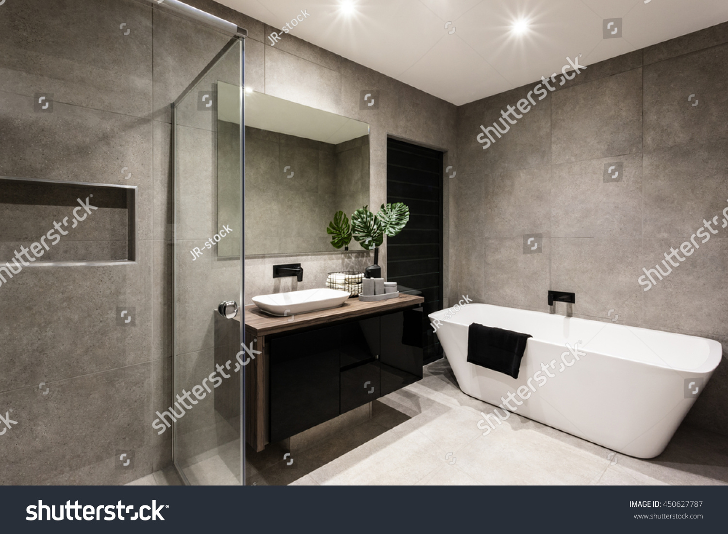 Modern Bathroom With A Shower Area And Bath Tub Including A Wall Mirror Besid