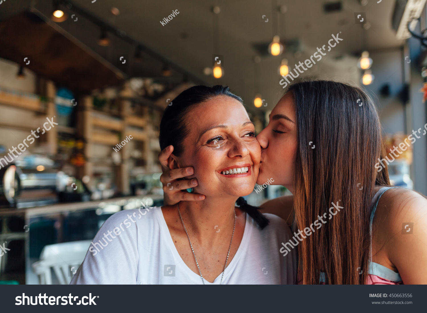 Love of mother and daughter Happy women in a nice cafe with copy space on blurred background Aged woman and her adult daughter drinking coffee at cafe Mothers day