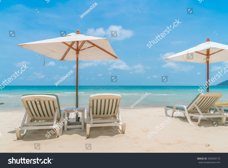 Beautiful Beach Chairs With Umbrella Tropical White Sand Beach Stock