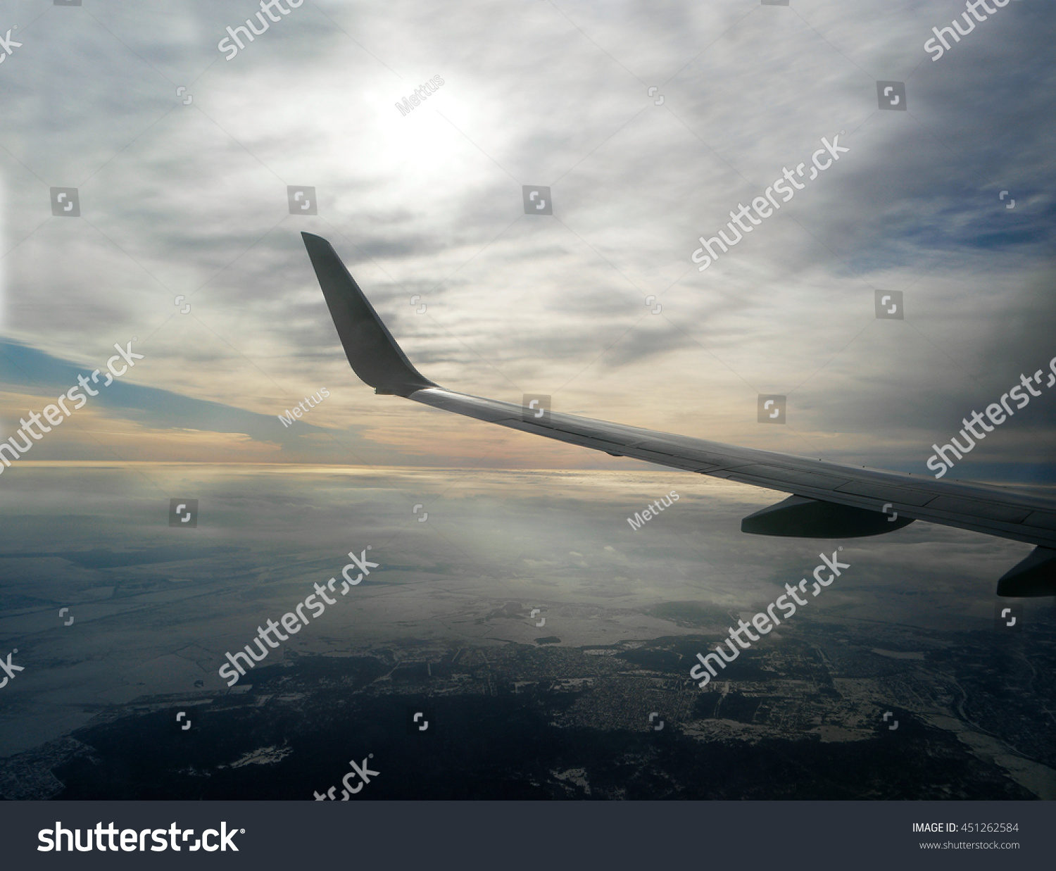 stock-photo-wing-of-aircraft-in-front-of
