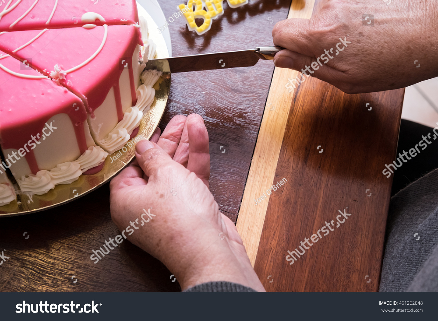 Ladys Hands Cutting Birthday Cake Candle Stock Photo Edit Now