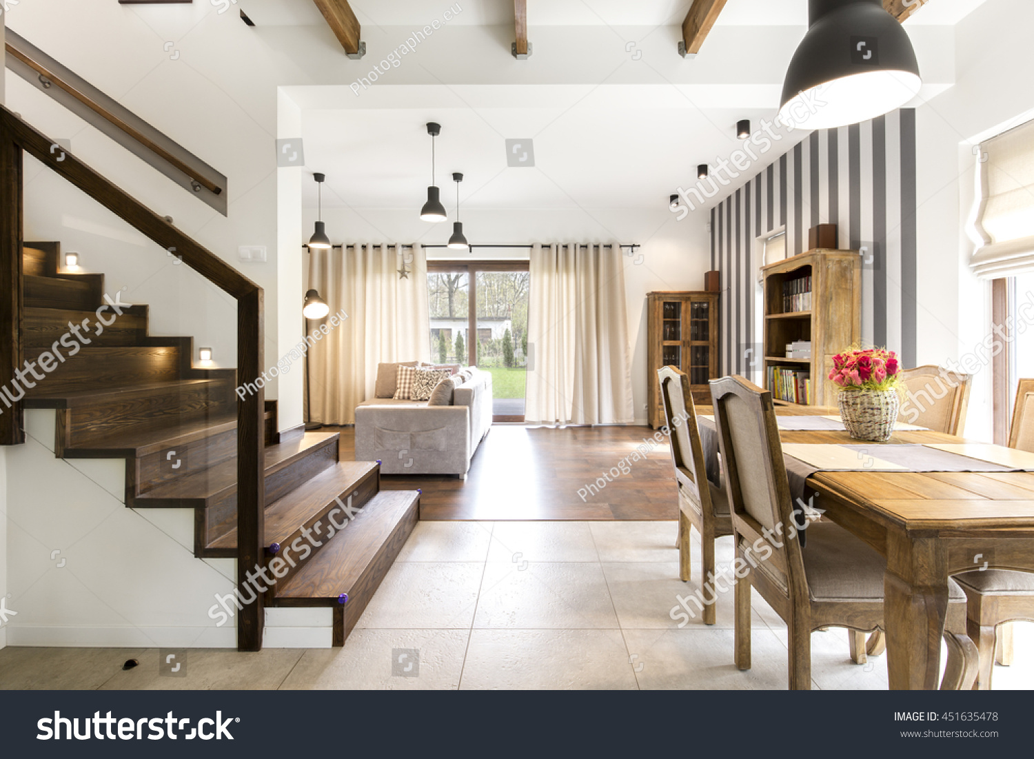 Big Elegant House With Spacious Dining Hall And Wooden Stairs On The First  Floor. In