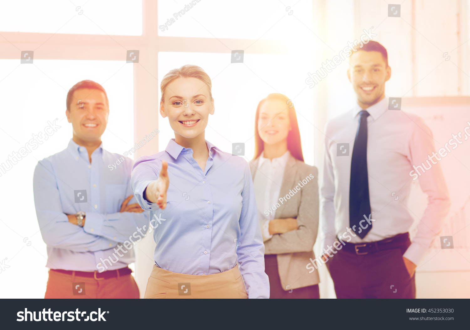 citizen office concept. Business And Office Concept - Smiling Beautiful Businesswoman Ready For Handshake With Team In Citizen