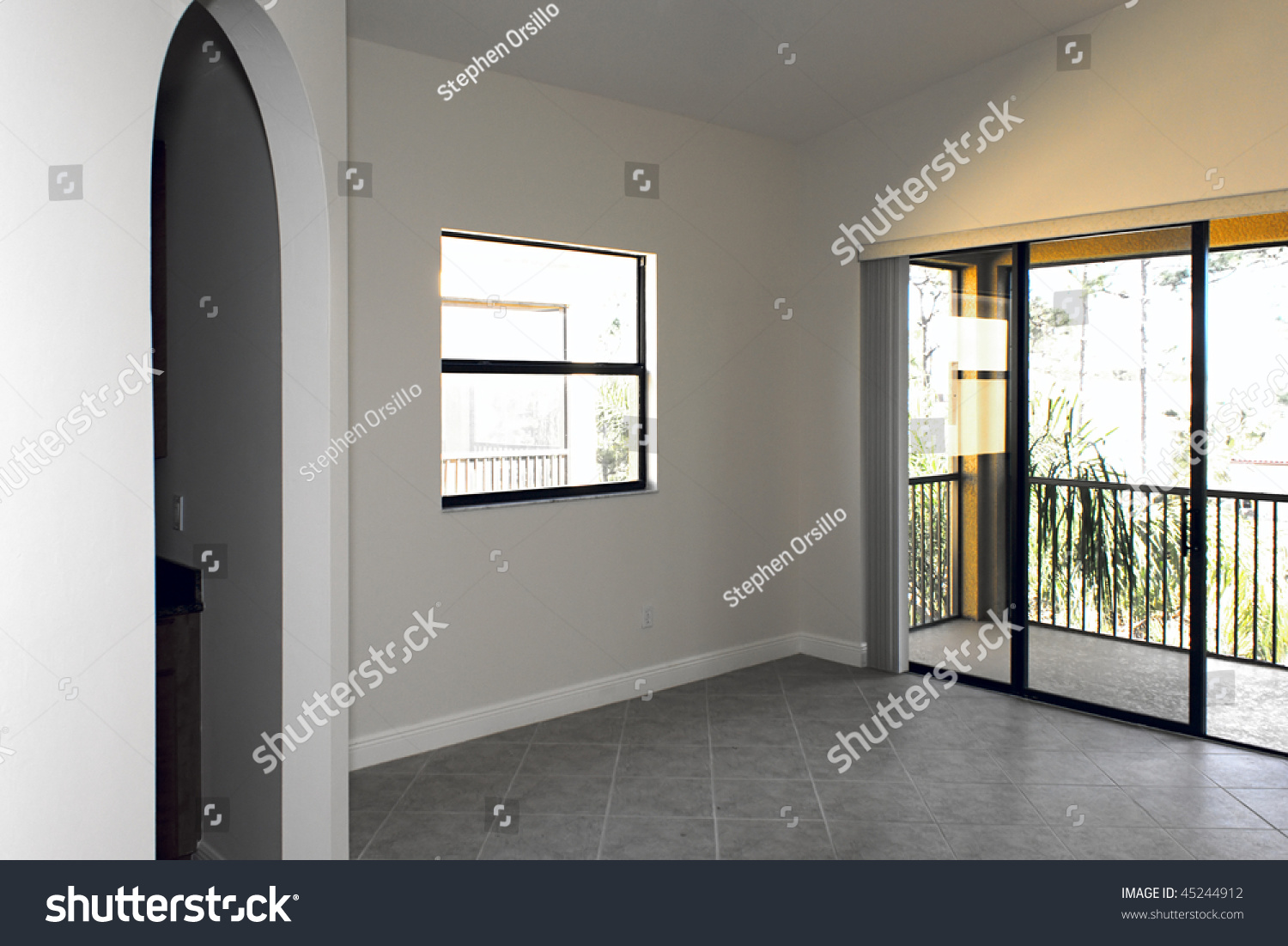 Large Empty Room With Arched Doorway, Window, And Sliding ...
